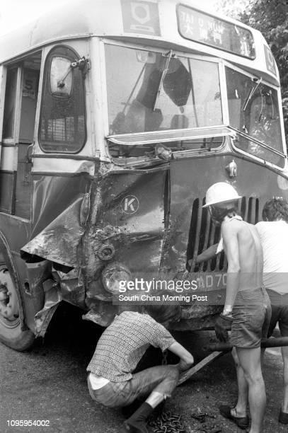 A chain is being attached to tow a crashed Kowloon Motor Bus in Clearwater Bay Road Sai Kung 03AUG77