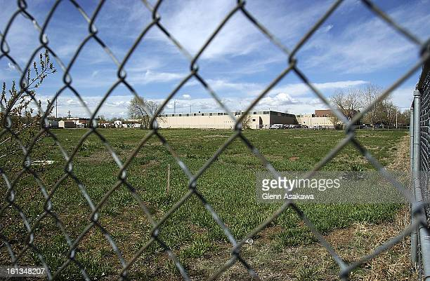 SUIT41803A chain link fence surrounds the site of the old Redfield Gunsight plant at 5800 E Jewell Ave which is now being used by Capco Tile and...