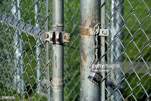 Chain link fence with broken lock.