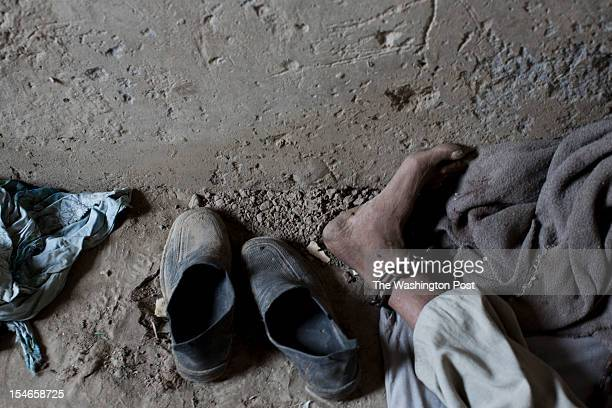 A chain locks an ankle of a person with a mental illness at the Mia Ali Sahib shrine outside Jalalabad Afghanistan on October 19 2012 Relatives bring...
