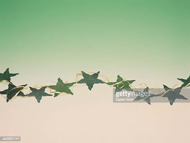 Chain of green stars with interwoven ribbon