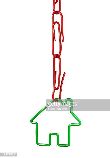 Chain of paperclips with a red paperclip house