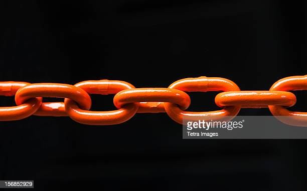 chain on black background, studio shot - chain stock pictures, royalty-free photos & images