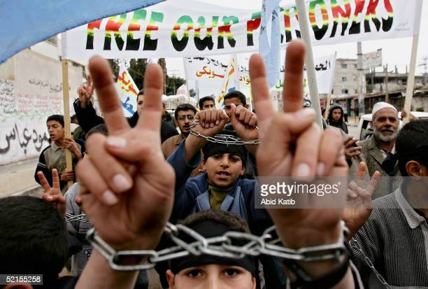 Chained Palestinian children call for the release of relatives and prisoners held in Israeli jails in Rafah refugee camp on February 8 2005 in Rafah...
