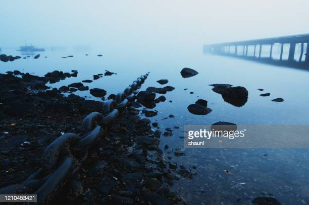 chained to the fog - undersea stock pictures, royalty-free photos & images