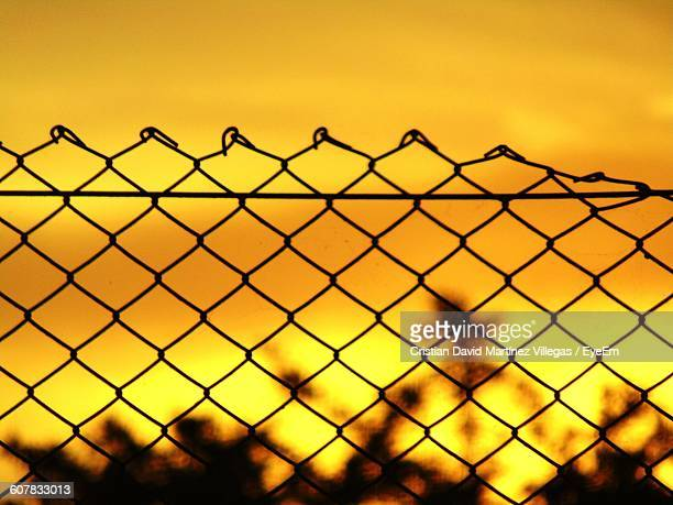Chainlink Fence Against Sky During Sunset