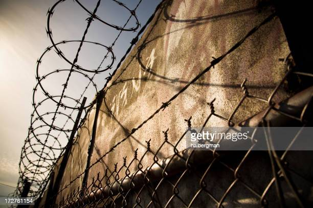 Chainlink fence with barbed wire