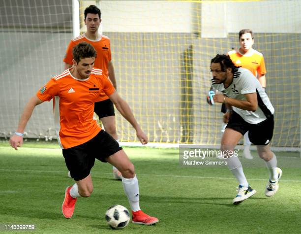 Chainsmokers DJ Andrew Taggart chases a loose ballduring the Copa Del Rave Charity Soccer Tournament at Evolve Project LA on April 17 2019 in Los...