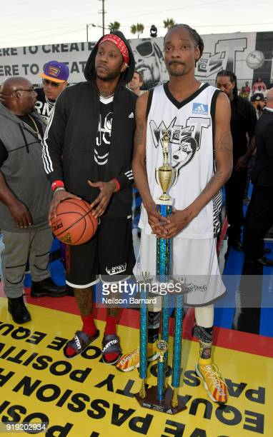 Chainz and Snoop Dogg pose with the trophy after the East Vs West game at adidas Creates 747 Warehouse St an event in basketball culture on February...