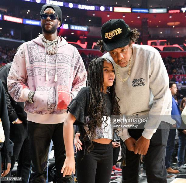 Chainz, Blue Ivy Carter and Jay-Z attend a basketball game between the Los Angeles Clippers and the Los Angeles Lakers at Staples Center on March 08,...