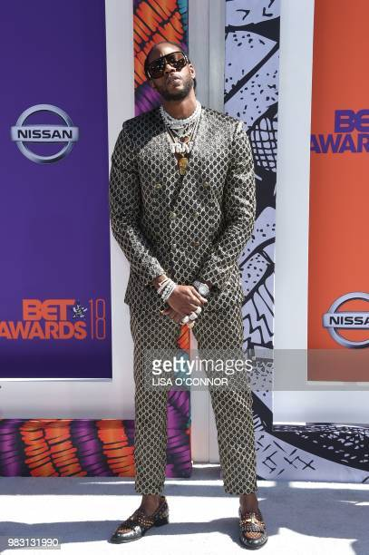 2 Chainz poses upon arrival for the BET Awards at Microsoft Theatre in Los Angeles California on June 24 2018
