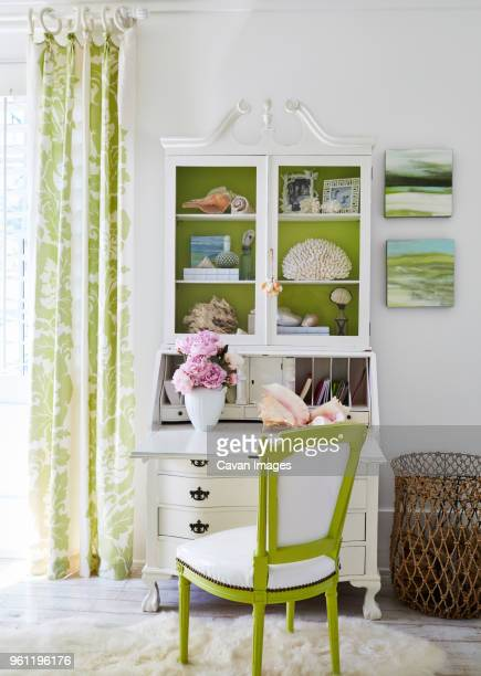chair and arranged cabinet in living room at luxury cottage - tidy room stock pictures, royalty-free photos & images