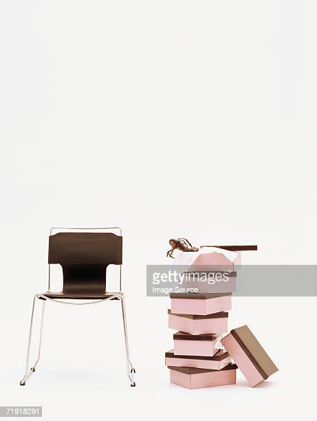 chair and pile of shoeboxes - シューズボックス ストックフォトと画像