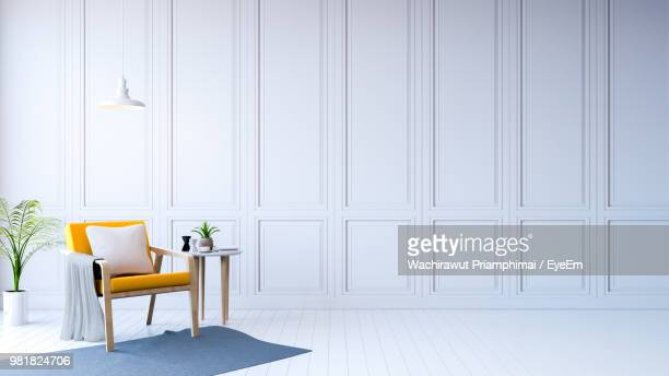 Chair And Table On White Floor At Home