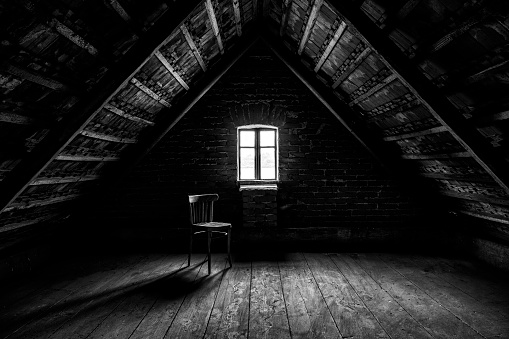 Chair and window in empty attic in grayscale - gettyimageskorea