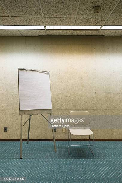 Chair and writing board in room