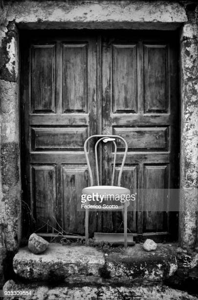 chair as a door blocker - bianco e nero stock pictures, royalty-free photos & images