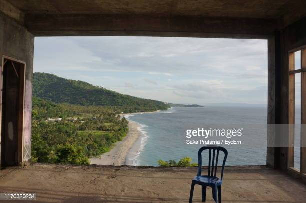 chair at abandoned building against sea - saka stock pictures, royalty-free photos & images