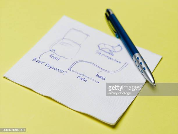 Chair design drawn on napkin, close-up