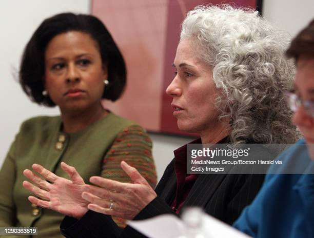 Chair Dr. Paula Johnson, left, Executive Director Barbara Ferrer and members of the Boston Public Health Commission discuss the issue of mini medical...