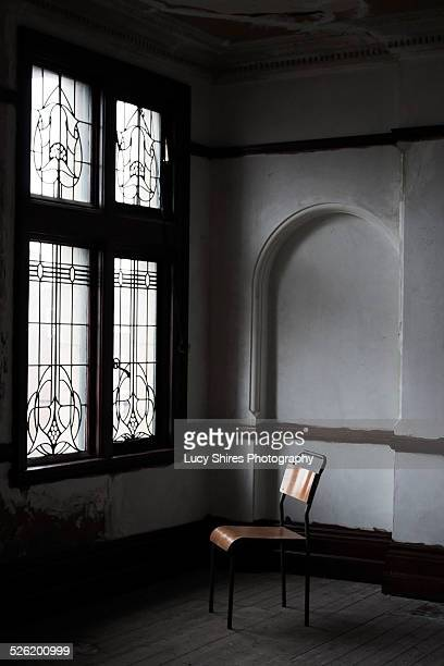 chair facing a window. - lucy shires stock pictures, royalty-free photos & images
