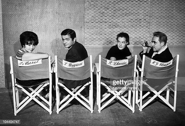 A chair for each member of the new film HELL's crew From left to right Dany CARREL Serge REGGIANI Romy SCHNEIDER and Henri Georges CLOUZOT Only four...