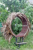 unusual circular wooden garden seat thatched