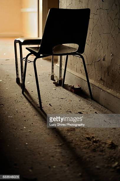 chair in abandoned hospital. - lucy shires stock pictures, royalty-free photos & images