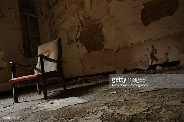 chair in an abandoned hospital - lucy shires stock pictures, royalty-free photos & images