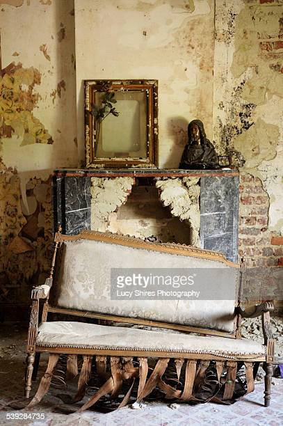 chair in front of fireplace - lucy shires stock pictures, royalty-free photos & images