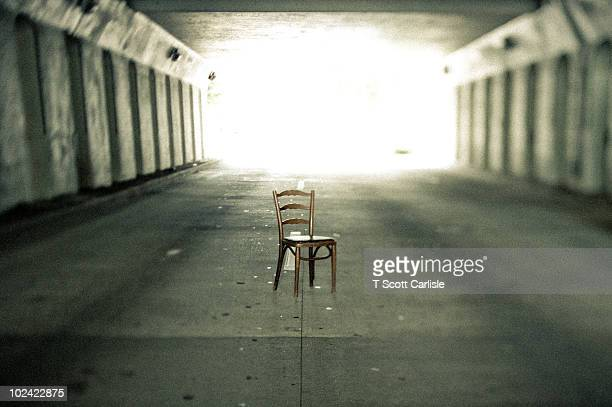 chair in road under viaduct - birmingham alabama stock pictures, royalty-free photos & images