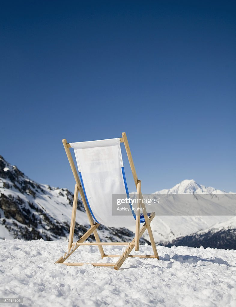 Chair in snow with view of French Alps : Stock Photo