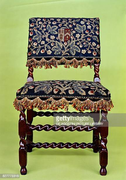 Chair in walnut wood with petit point embroidery and upholstered seat and backrest 16501660 England 17th century London Victoria And Albert Museum