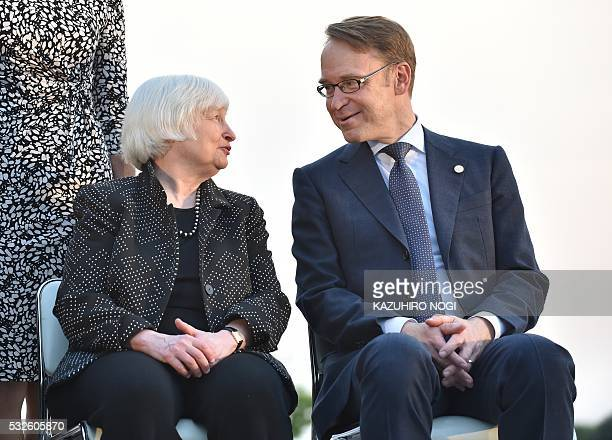US FRB chair Janet Yellen chats with Governor of the Deutsche Bundesbank Jens Weidmann prior to a photo session at the Sendai Castle site in Sendai...