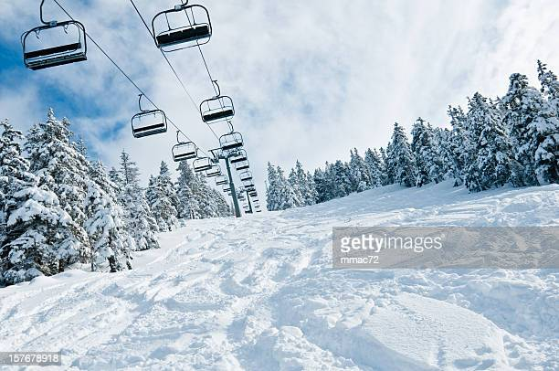 chair lift in snowy winter landscape - ski lift stock pictures, royalty-free photos & images