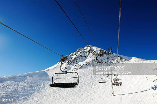 chair lift - meribel stock photos and pictures