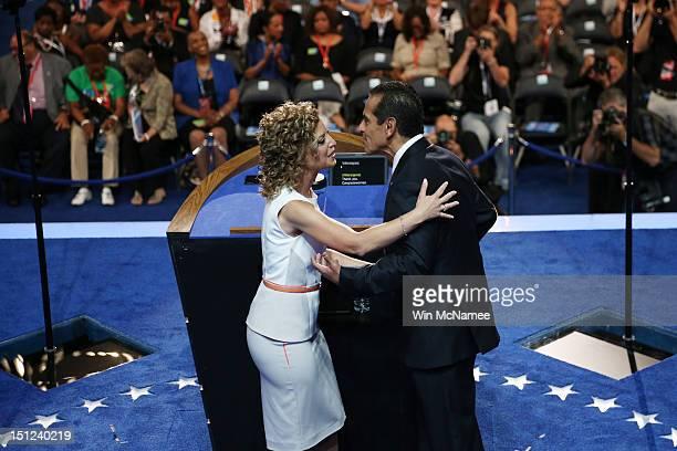 Chair Los Angeles Mayor Antonio Villaraigosa greets Democratic National Committee Chair US Rep Debbie Wasserman Schultz on stage during day one of...