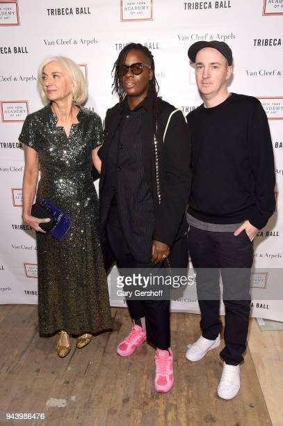 Chair of Board Eileen Guggenheim event honoree artist Mickalene Thomas and artist KAWS attend the 2018 TriBeCa Ball at New York Academy of Art on...