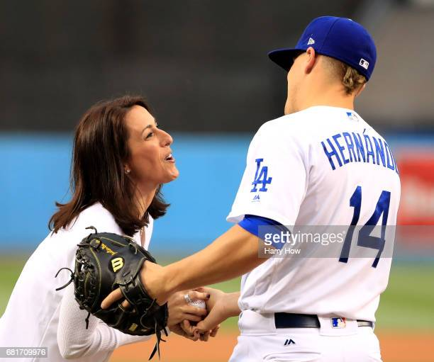 Chair of LA2024 Bid Committee's Athletes' and Olympian Janet Evans shakes hands with Enrique Hernandez of the Los Angeles Dodgers after throwing out...