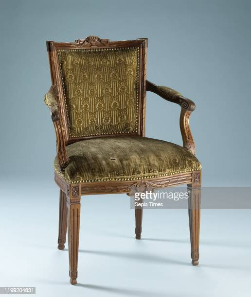 Chair of mahogany covered with string with a continuous pattern of oval hanging flowers in which a flower on striped ground covered with string with...