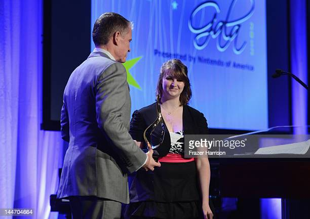 Chair of Morrison Foerster LLP Keith Wetmore and Nikki Riddle speaks onstage at the Starlight Children's Foundation Annual A Stellar Night Gala held...