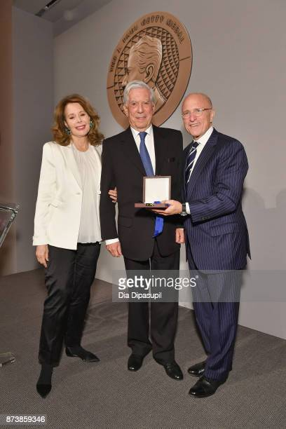 Chair of the Board of Trustees of the J Paul Getty Trust Maria HummerTuttle 2017 Getty Medal Award Recipient Mario Vargas Llosa and Jim Cuno pose for...