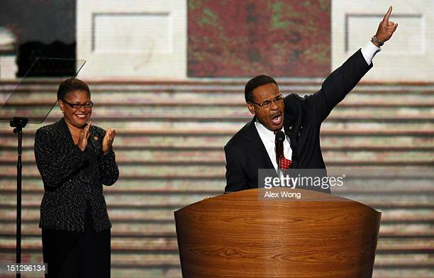 Chair of the Congressional Black Caucus US Rep Emanuel Cleaver II speaks as US Rep Karen Bass stands on stage during day two of the Democratic...