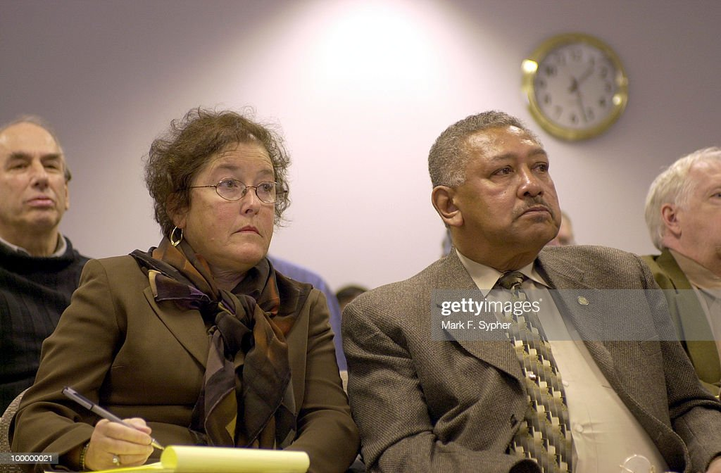 Chair of the Southeast Citizen's for Smart Development, Inc., Wilbert Hill,right, is joined by vice chair, Ellen Opper-Weiner, left,at a public zoning hearing that will decide the fate of the development of a Boys and Girls Town in the 1300 block of Potomac Avenue, S.E..