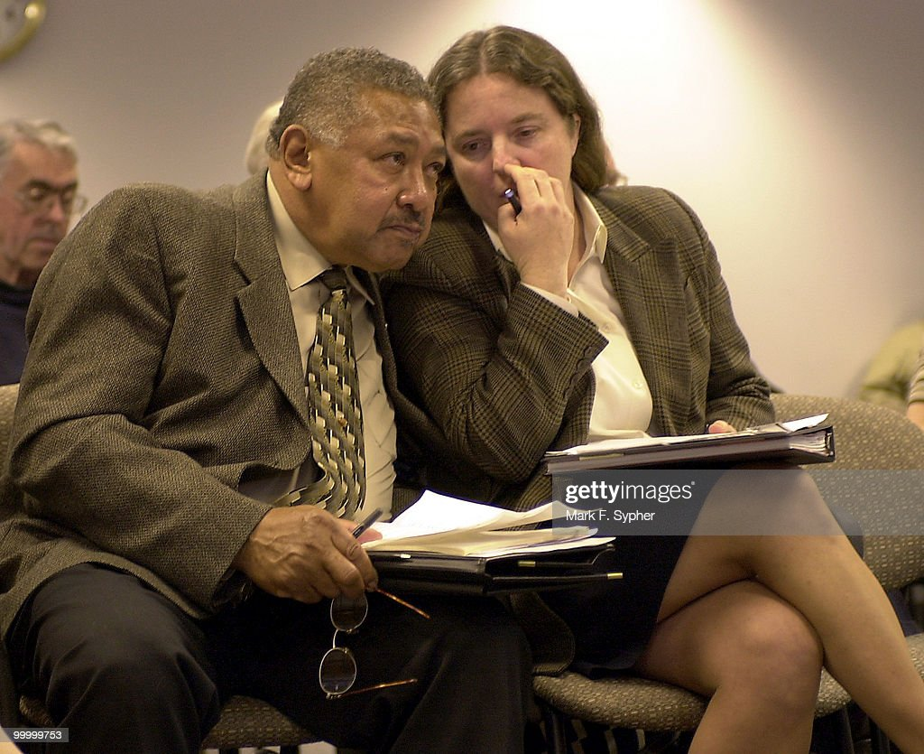 Chair of the Southeast Citizen's for Smart Development, Inc., Wilbert Hill, left, lends an ear to (Jen Yachin, insert here), during the hearing concerning the development of a Boys and Girls Town in the 1300 block of Potomac Avenue, S.E..