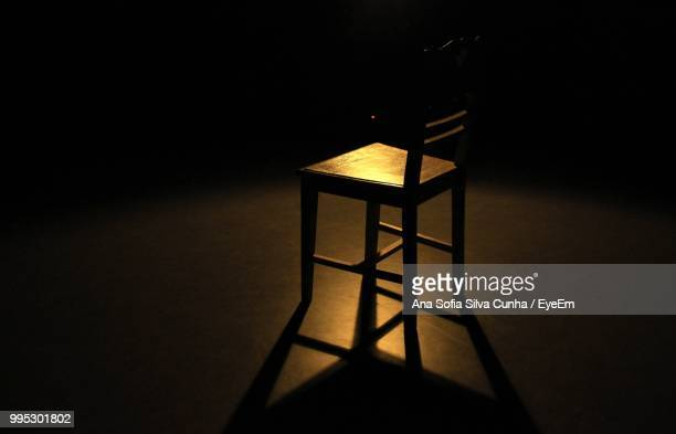 Chair On Floor In Illuminated Room