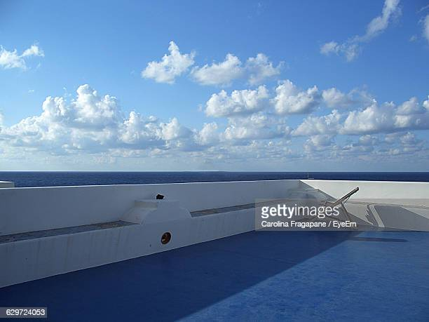 chair on ship at sea against sky - carolina fragapane stock pictures, royalty-free photos & images