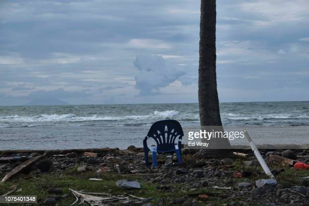 A chair sits on a beach as the Anak Krakatau volcano emits clouds of hot gas and ash on December 28 2018 in Banten Indonesia Flights have been...
