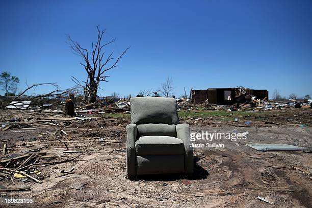 A chair sits on a plot of land where a home once stood June 2 2013 in Moore Oklahoma Residents of Moore Oklahoma continue to recover and sift through...