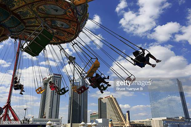 Chair swing ride with cityscape